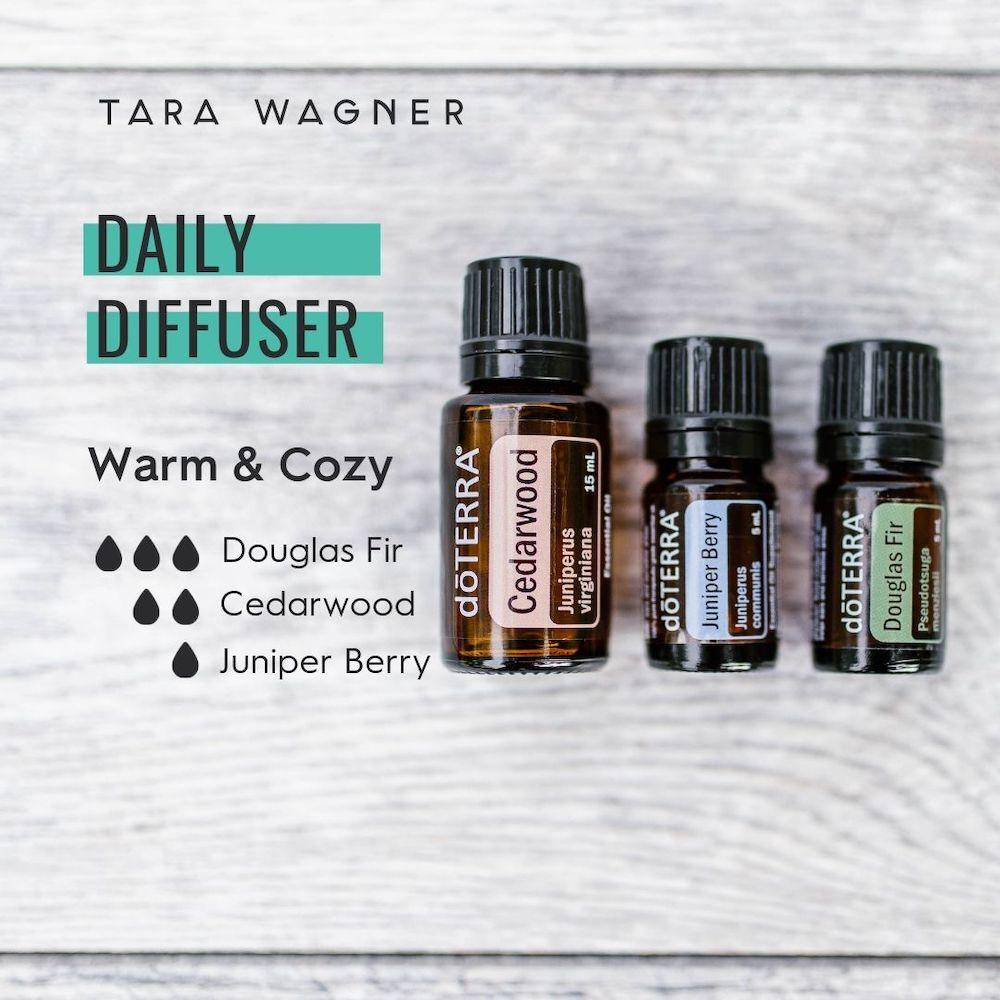Diffuser recipe called Warm and Cozy depicting the recipe: 3 drops juniper berry, 2 drops cedarwood, and 1 drop juniper berry essential oils