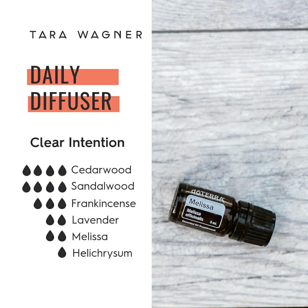 Diffuser recipe called Clear Intention depicting the recipe: 4 drops cedarwood, 4 drops sandalwood, 3 drops frankincense, 2 drops lavender, 2 drops Melissa, and 1 drop helichrysum essential oils