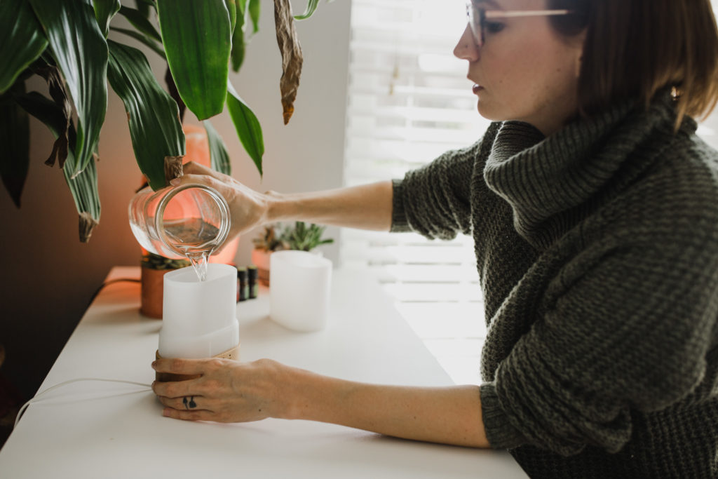 Tara pouring water into a diffuser