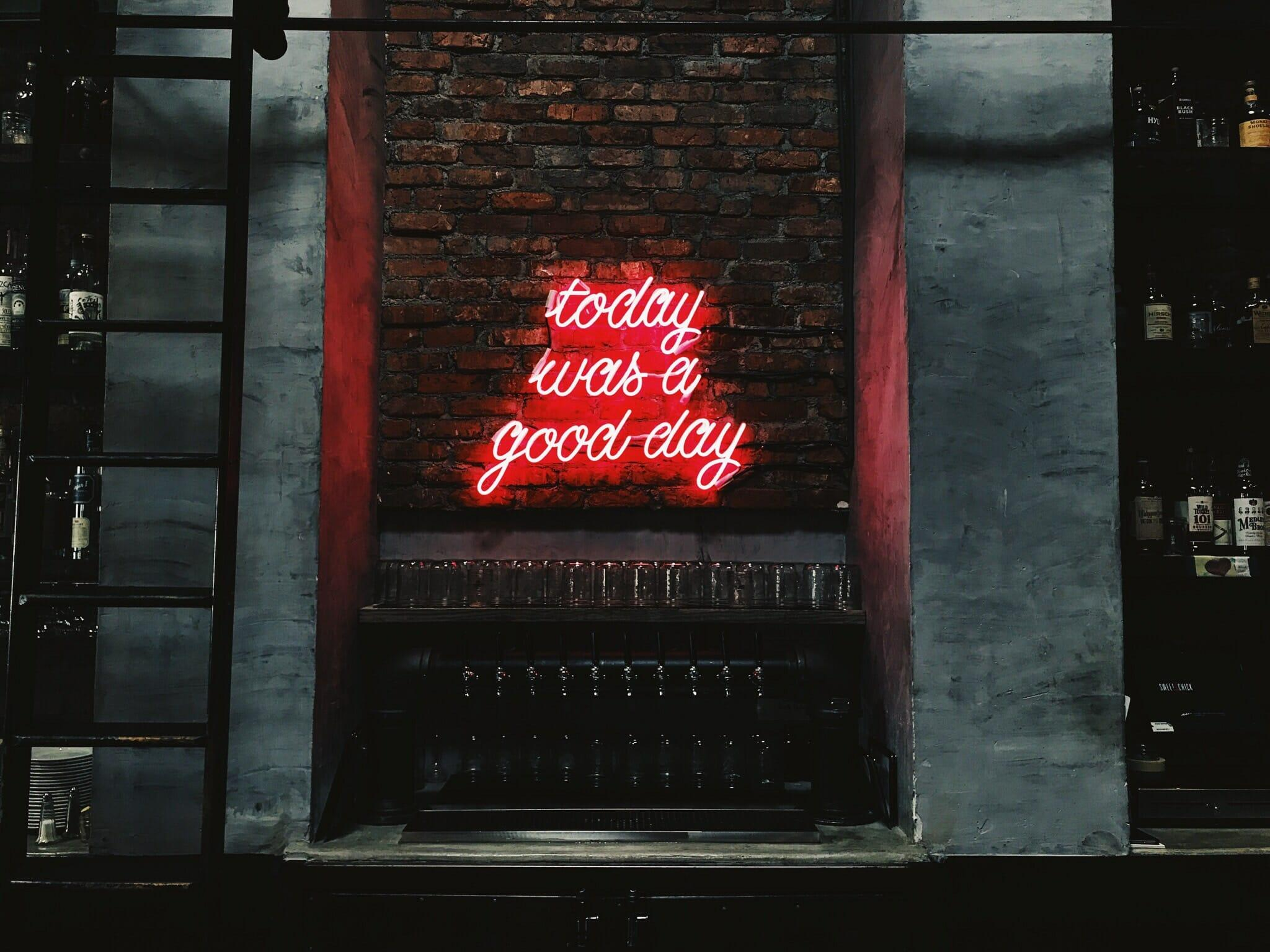 """red neon sign on brick wall that says """"today was a good day"""""""