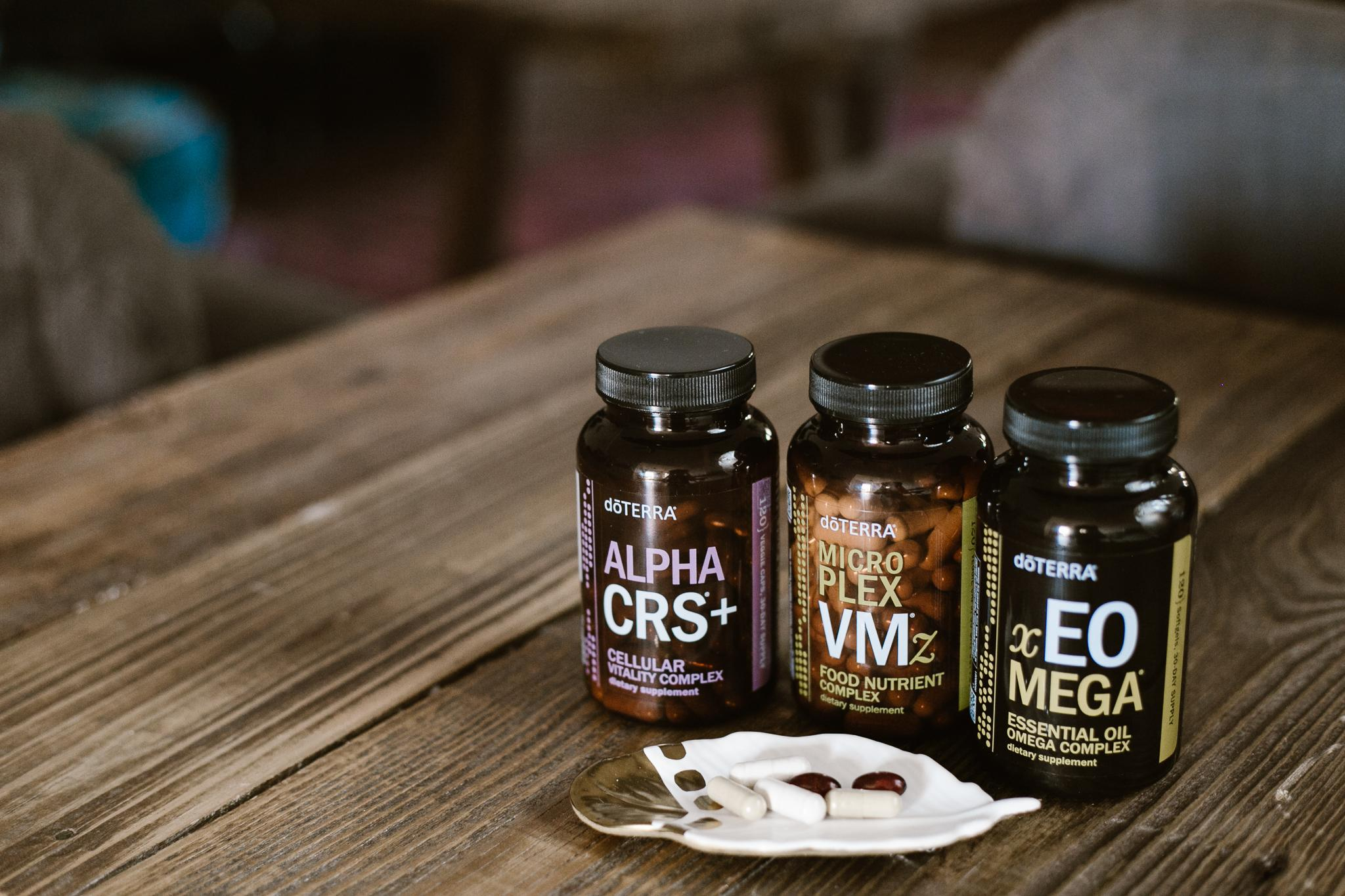 doTERRA Long Life Vitality supplements on wood table