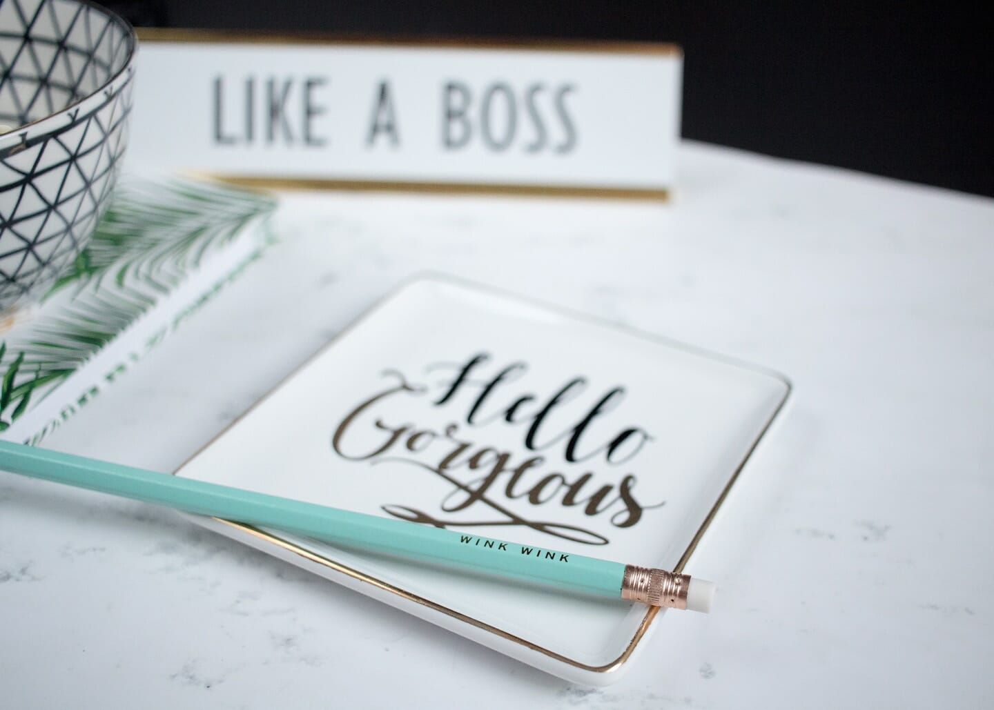 "Notebook with ""Hello Gorgeous "" on the cover, ""Like a Boss"" name plate and light blue pencil"