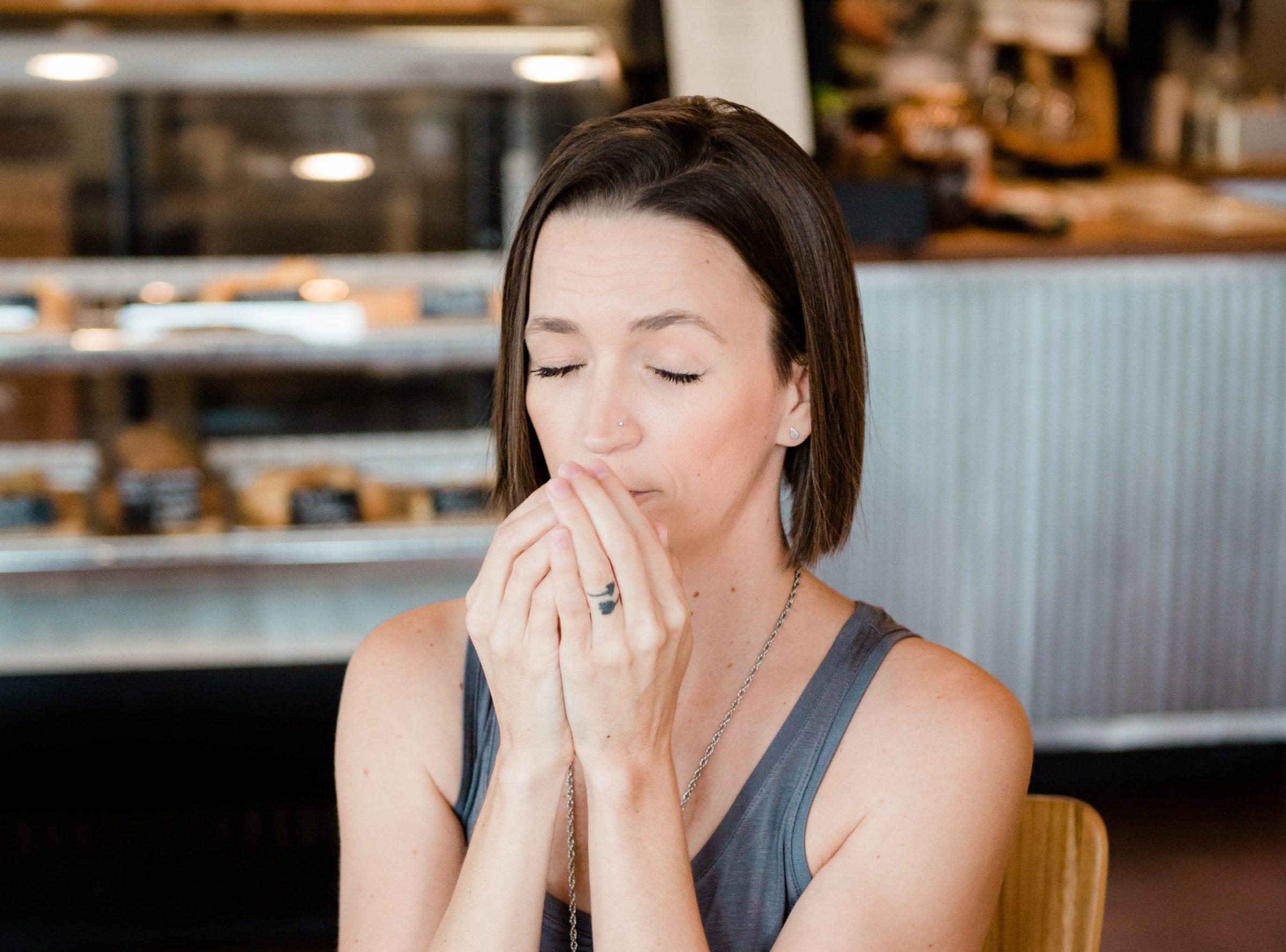 Tara smelling oils on hands