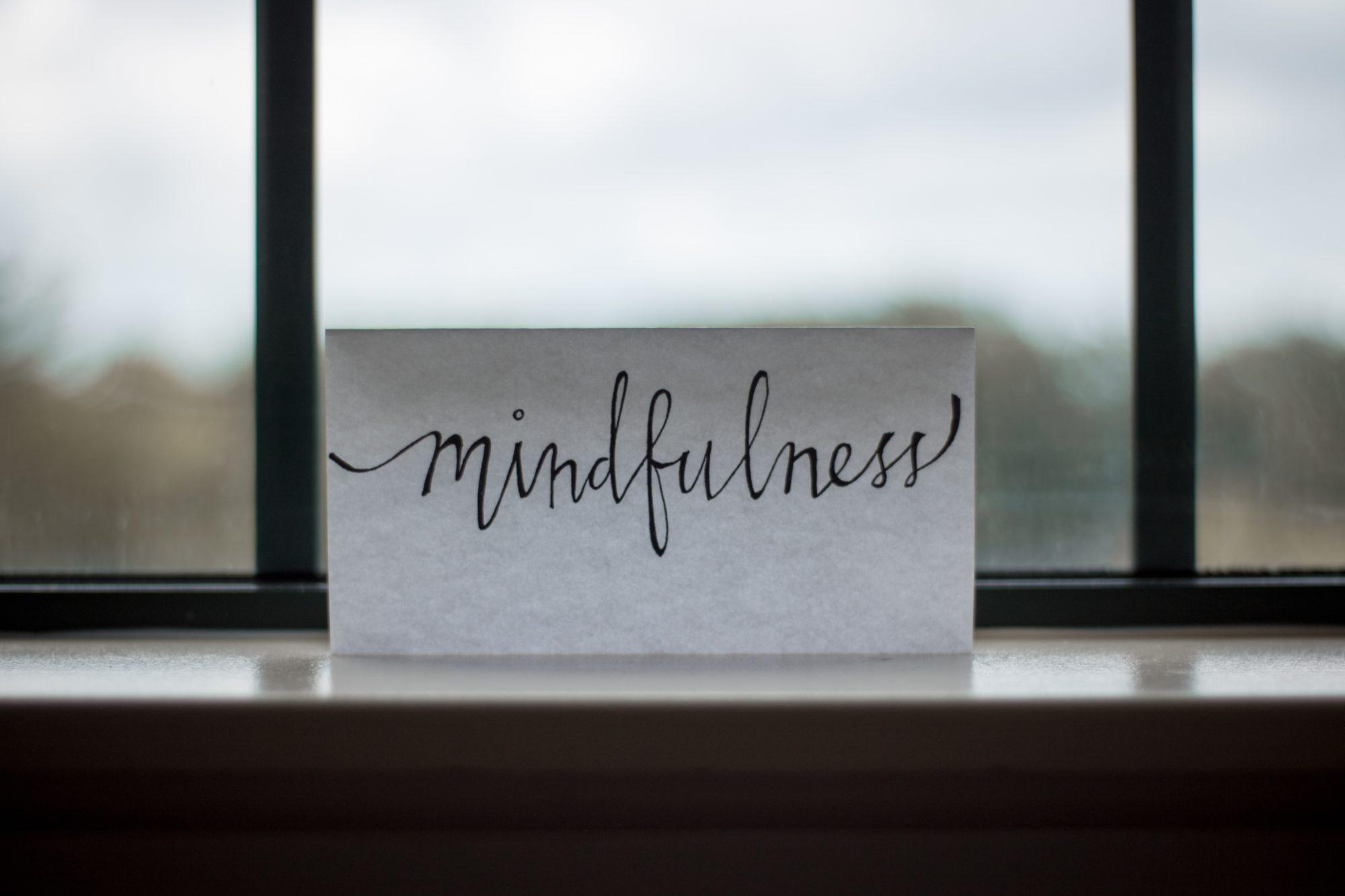 "the word ""mindfulness"" on a piece of pape in the window"