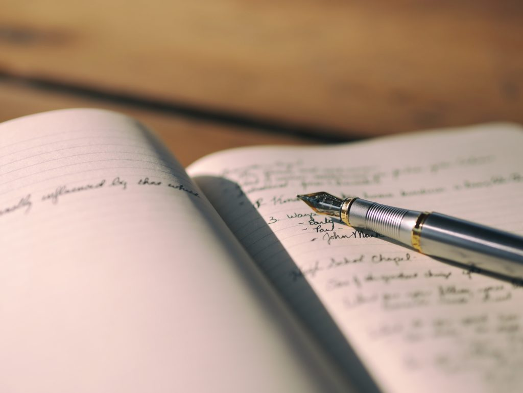 pen and journal with writing