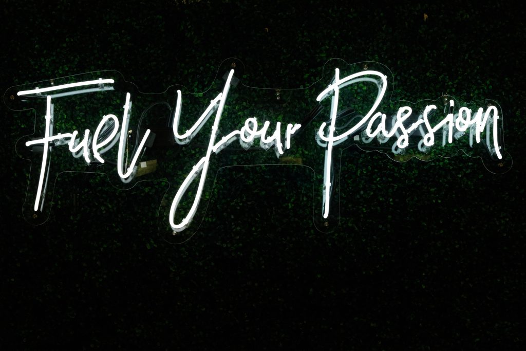 Fuel Your Passion in handwriting-esque neon lights