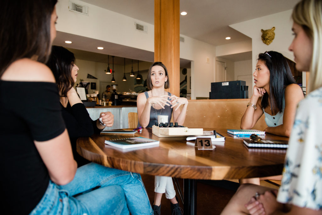 Tara talking to a group of women around a table in a coffee shop