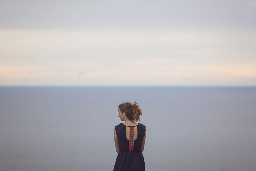 woman looking over ocean