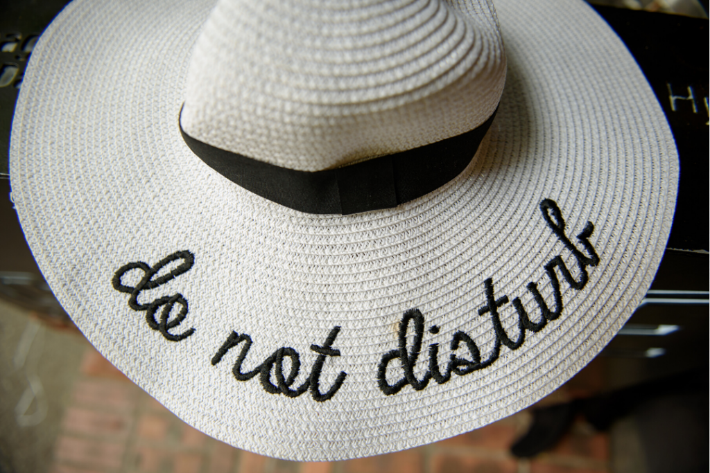 "Wide brimmed hat that says ""do not disturb"" - How to Stop Distractions blog"
