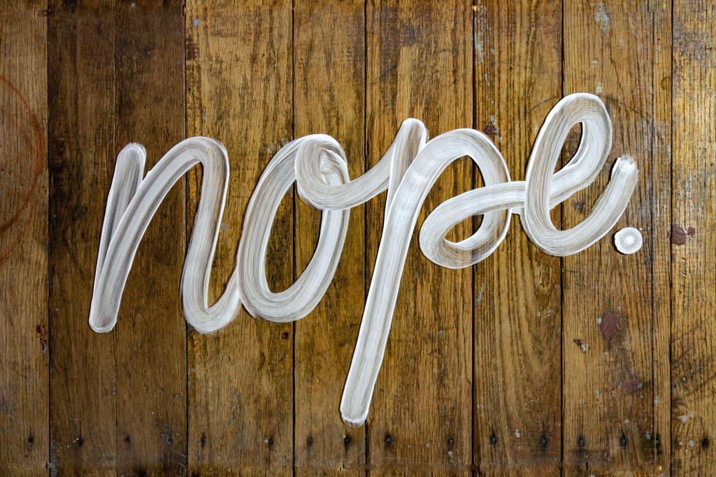 """nope"" painted on wood"