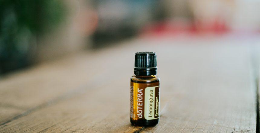 Lemongrass Essential oil bottle on wooden table